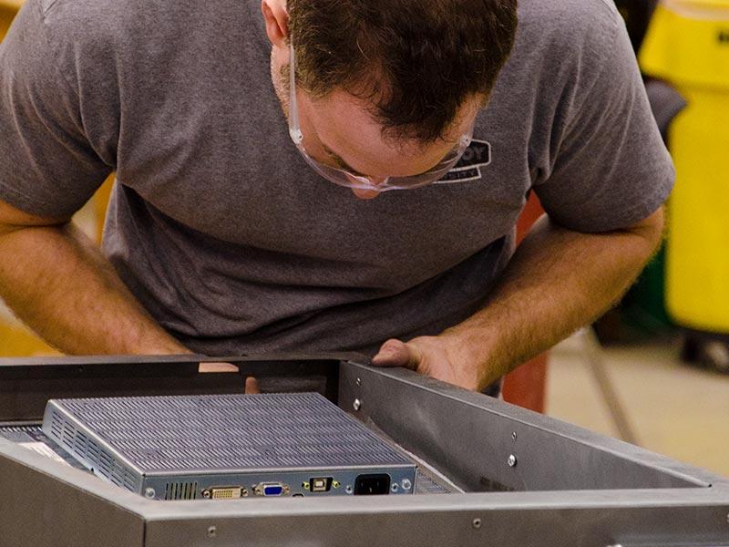 Assembling the hardware portion of the kiosk.