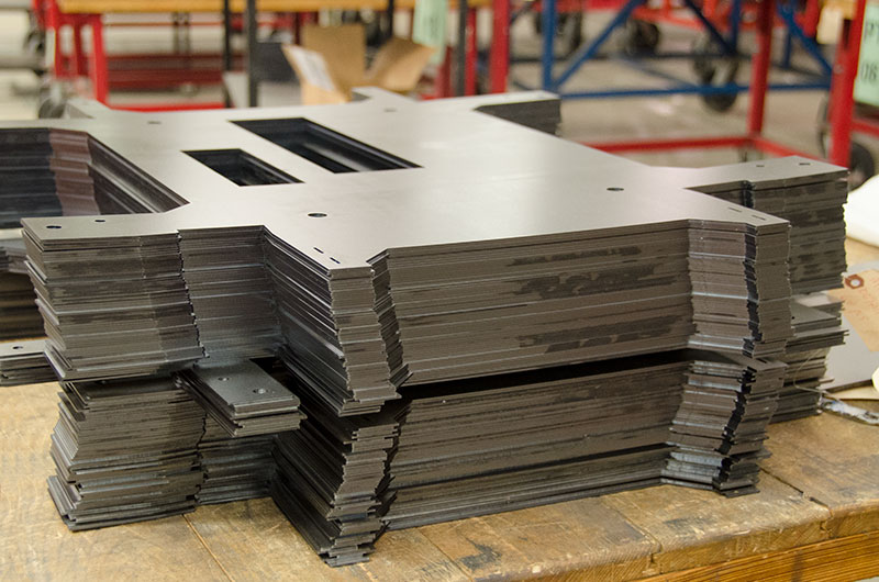 Cut sheet metal panels are stacked and ready for delivery.