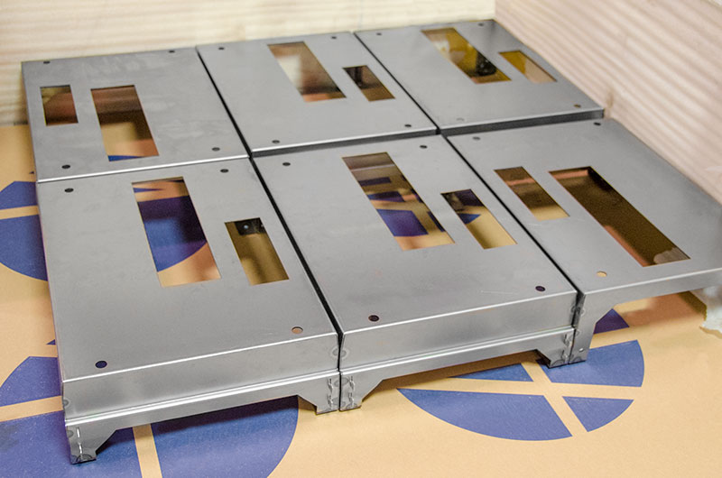Welded and finished metal panels are ready for packaging.