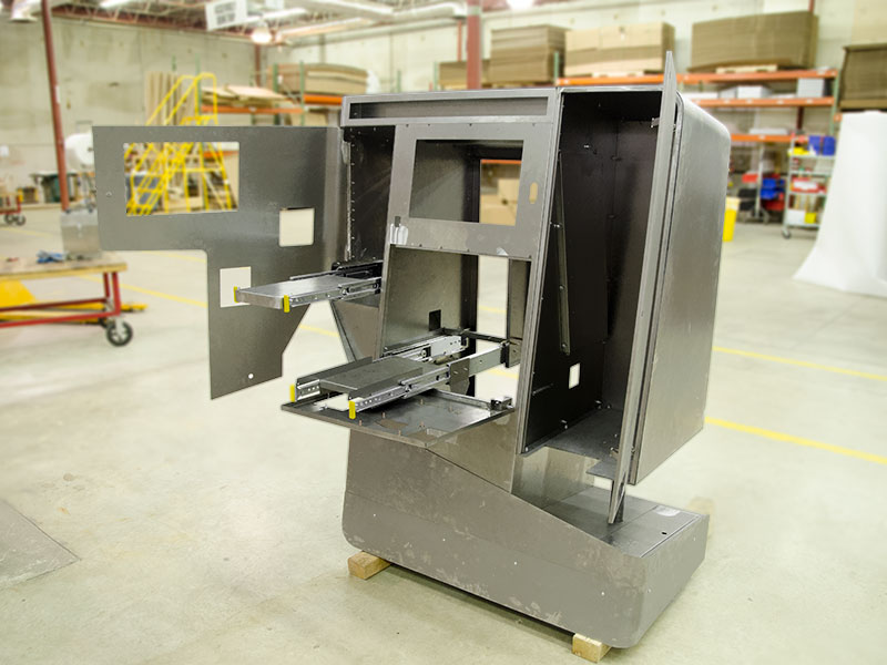 Movable components are rigorously tested on a kiosk before finishing touches.