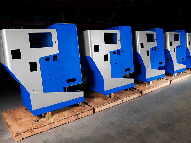 Fully-assembled kiosks are ready for screens and other final components before they are packaged for shipping.