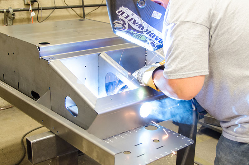 Sheet metal is welded to the main assembly.