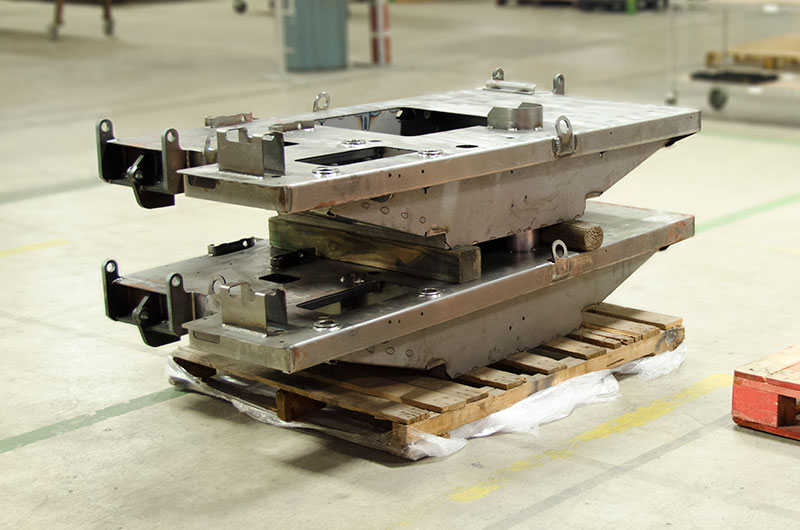 Welded assemblies are placed on a palette to be transported to another part of the facility for finishing touches.