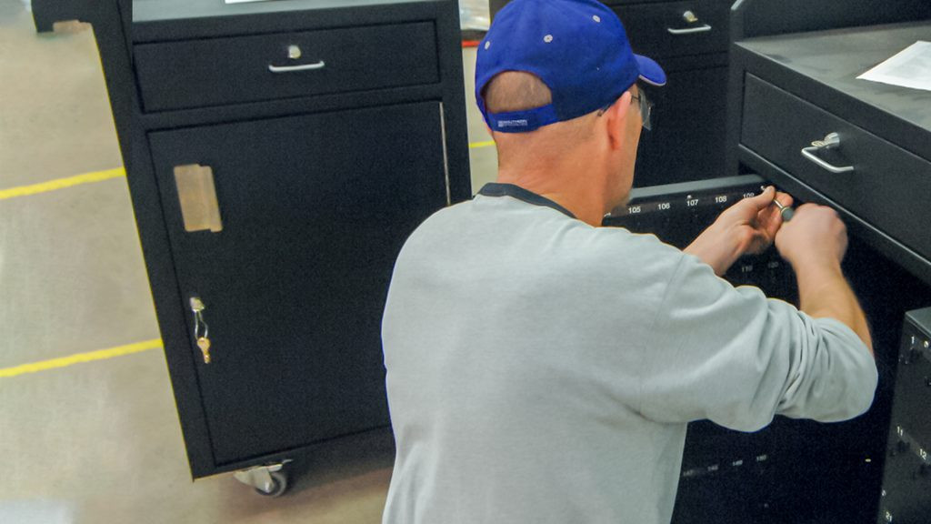 A technician installs the final pieces of a custom product manufacturing project