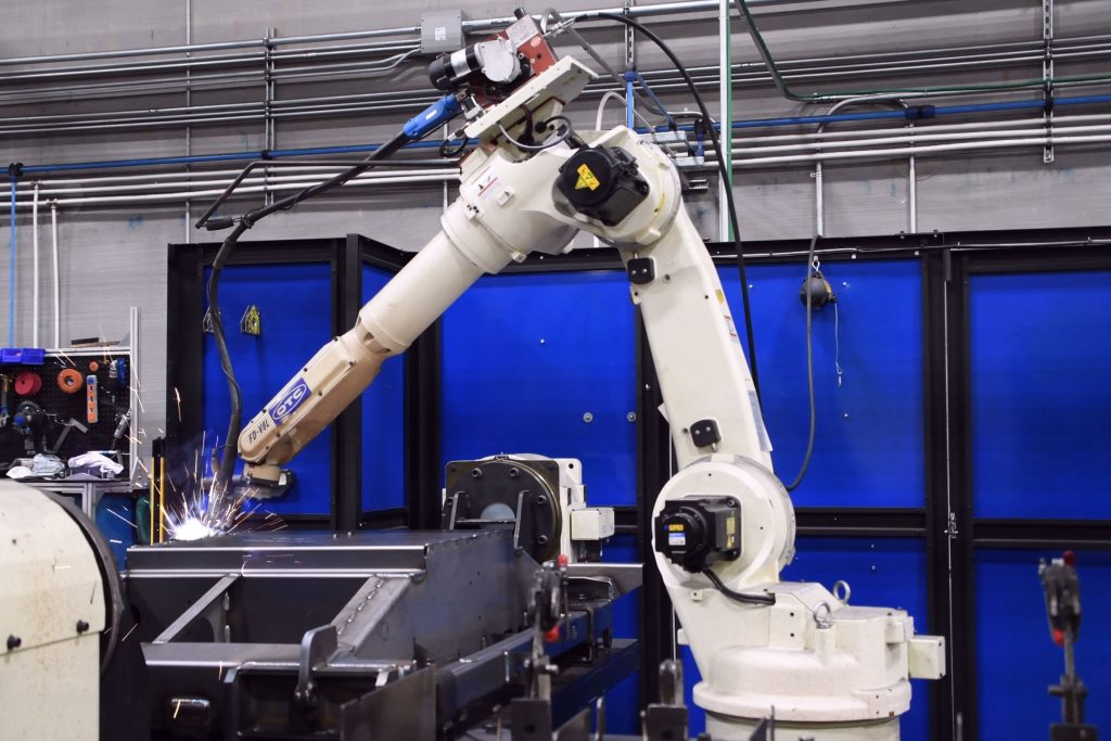 A welding robot welds several points on an assembly